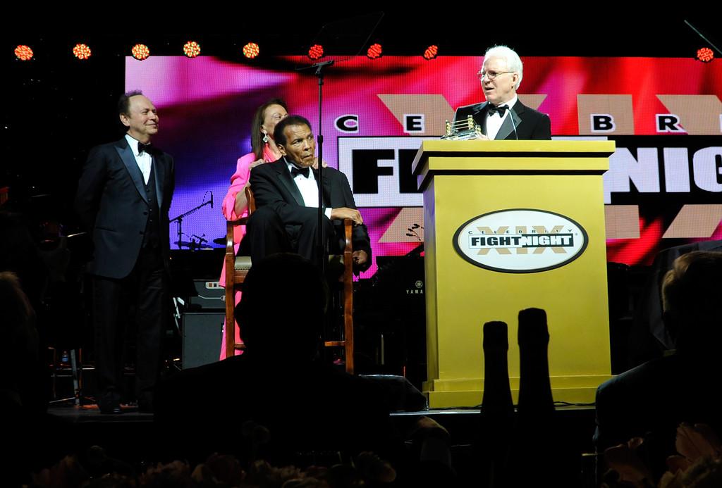 Martin accepts his humanitarian award from Crystal and Ali